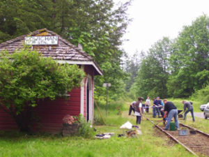 Cowichan Station volunteers clear weeds from their adopted mile of corridor.
